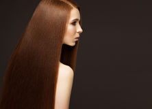 Beautiful Redheadgirl with a perfectly smooth hair and classic make-up. Beauty face. stock images