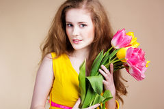 Beautiful redheared girl with bouquet of tulips Royalty Free Stock Image