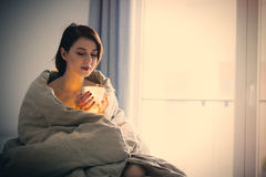 Beautiful Rednead Woman With Cup Of Coffee Or Cappuccino In Bed Stock Images