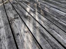 Beautiful reflecting diagonal stripes onto wood floor with sunlight. stock image