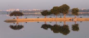 Beautiful reflection on a lake at early morning. At Hyderabad, Andhra Pradesh, India. This pic is from Hussain Sagar lake Stock Photo