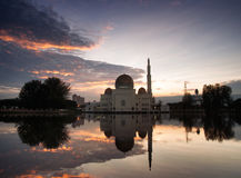 Beautiful reflection of mosque with sunrise background. Mosque at sunrise at masjid puchong stock image