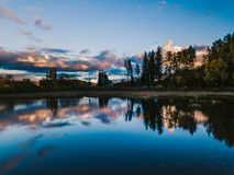 Reflection of nature in water in autumn. Beautiful Reflection of Nature in Water in Sunny Autumn Evening stock photo