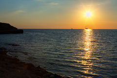 Beautiful reflection of rays setting sun in the Black Sea. Royalty Free Stock Images