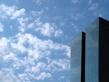 Beautiful reflection and sky. Saw this picture at a street downtown. The sky is so beautiful, this is two office blocks very close to each other. The sky is Royalty Free Stock Photography