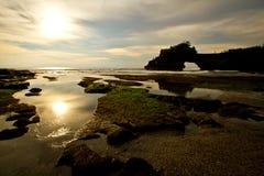 Sunset at Tanah Lot Bali. Beautiful reflection of the sun during sunset at Tanah Lot Bali stock photography