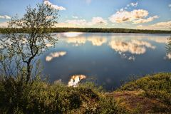 Beautiful reflections in Finnish lakes. The beautiful reflections in Finnish lakes Royalty Free Stock Photography