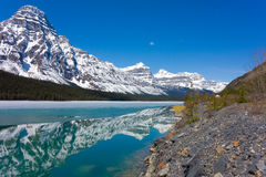 Beautiful reflections in a half-frozen lake in british columbia Royalty Free Stock Photos