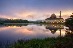 Beautiful reflections of mosque during sunrise. Darul Quran mosque reflections at sunrise Royalty Free Stock Images