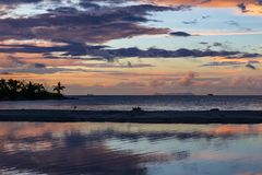 Beautiful reflections on the ocean of sunset in Fiji stock image