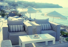Beautiful relax terrace with armchairs on sea coast, Grete, Gree Royalty Free Stock Photos