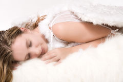 Beautiful relaxed angel in the clouds Royalty Free Stock Photo