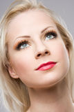 Beautiful relaxed blond woman in elegant makeup. Stock Images