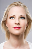 Beautiful relaxed blond woman in elegant makeup. Stock Photography