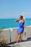 Beautiful relaxed blonde young woman wearing fashionable blue cl Stock Photos