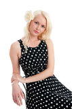 Beautiful relaxed female in polker dot dress Royalty Free Stock Photography