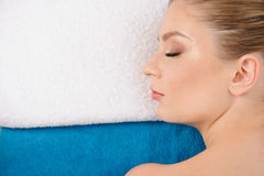 Beautiful relaxed female ready for a spa treatment. Close-up of relaxed female ready for a spa treatment Royalty Free Stock Image