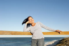Beautiful relaxed mature woman ocean background Stock Image