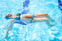 Beautiful relaxed pregnant woman in swimmingpool Royalty Free Stock Photo