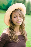 Beautiful relaxed spring brunette outdoors. Royalty Free Stock Image