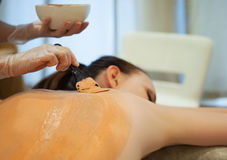 Beautiful relaxed woman having clay body mask Royalty Free Stock Photo