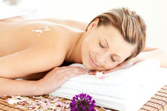 Beautiful relaxed woman lying on a massage table Stock Photos