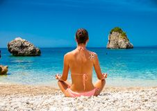 Relaxed young  woman has a meditation. Greece. Stock Photography