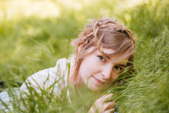 Beautiful relaxed young woman lying on grass Royalty Free Stock Photos