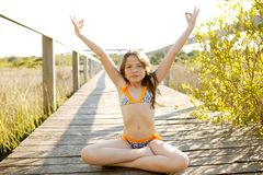 Beautiful relaxed zen teen meditation in bikini Royalty Free Stock Photography