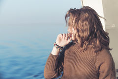 Beautiful relaxing blond teenage girl, seaside Royalty Free Stock Photography
