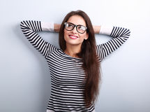 Beautiful relaxing woman in glasses looking up with thinking loo Stock Photo