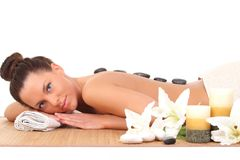 Relaxing woman with stones on her back in a Spa. Beautiful relaxing woman with stones on her back in a Spa Royalty Free Stock Photo