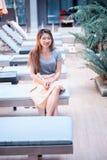 Beautiful relex on lounger near swimming pool in hotel, krabi,. Asia beautiful relex on lounger near swimming pool in hotel, krabi, Thailand Stock Image