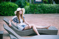 Beautiful relex on lounger near swimming pool in hotel, krabi, T. Asia beautiful relex on lounger near swimming pool in hotel, krabi, Thailand Royalty Free Stock Photos