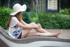 Beautiful relex on lounger near swimming pool in hotel, krabi, T. Asia beautiful relex on lounger near swimming pool in hotel, krabi, Thailand Royalty Free Stock Photography