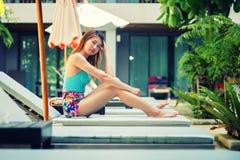 Beautiful relex on lounger near swimming pool in hotel, krabi, T. Asia beautiful relex on lounger near swimming pool in hotel, krabi, Thailand Royalty Free Stock Image