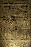A beautiful relief and hieroglyphs on an interior wall at the Temple of Isis at Philae in Egypt. Royalty Free Stock Photography