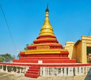 Relief pagoda of U Min Thonze Temple, Sagaing. The beautiful relief pagoda of U Min Thonze Temple with red and gilt belts and old hti umbrella on the top stock photography