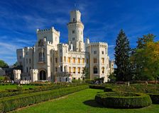 Beautiful renaissance castle Hluboka i the Czech Republic, with nice garden and blue sky Royalty Free Stock Images