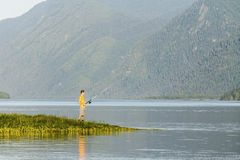 Beautiful reservoir in Siberia and the fisherman ashore Stock Photography