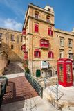 Beautiful residential area in old town of Valletta,Malta. With red phone booth Royalty Free Stock Photography