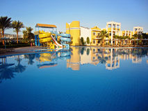 Beautiful resort hotel with pool and aqua sliders Royalty Free Stock Photos