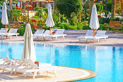 Beautiful Resort Pool. Luxurious open air swimming pool at resort Stock Photos