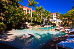 Beautiful Resort Swimming Pool. Resort swimming pool surrounded by lush tropical gardens Royalty Free Stock Image