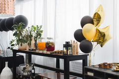 Beautiful restaurant with nice interior. A lot of balloons near the tabble. Drinks are varicoloured stock photo