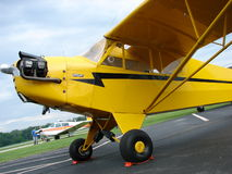 Beautiful restored classic Piper J3 Cub. The photo of this beautiful restored classic Piper J3 Cub was taken at the Marion Municipal Airport in Marion, Indiana Royalty Free Stock Images