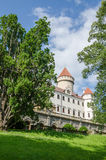 Beautiful restored white castle with red tiles and blue sky in Czech Republic Royalty Free Stock Image