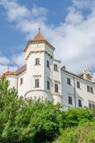 Beautiful restored white castle with red tiles and blue sky in Czech Republic. Surrounded by green gardens Royalty Free Stock Photos