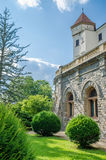 Beautiful restored white castle with red tiles and blue sky in Czech Republic. Surrounded by green gardens Royalty Free Stock Photography