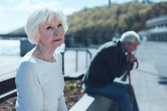 Beautiful retired woman thinking of her younger self royalty free stock images
